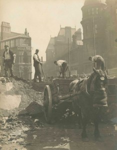 An image of workmen disposing of rubble.