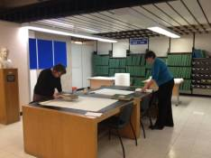 Staff are making covers to wrap volumes in our local studies collections.