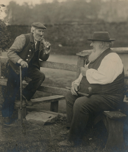 Villagers smoking pipes at Astley, Warwickshire. The gentleman on the right is believed to have been the village postmaster. 1896. [MS 2724/2/B/1999]