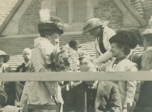 Miss Phoebe Robinson presents Mrs George Cadbury with a bouquet [MS 466/41 Box 8/42]