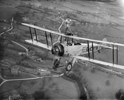 Stunt Man on Biplane: Aerofilms Collection / English Heritage Reference EPW037854 Photo by Aerofilms.  Copyright – English Heritage