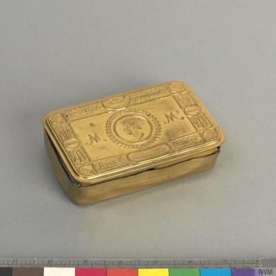The Lusitania was believed to have been carrying the brass strips used to make these tins which were sent to soldiers fighting at the Front.© IWM (EPH 9380)